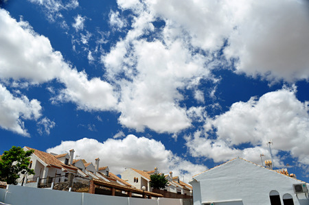 white houses and blue sky with clouds Stock Photo