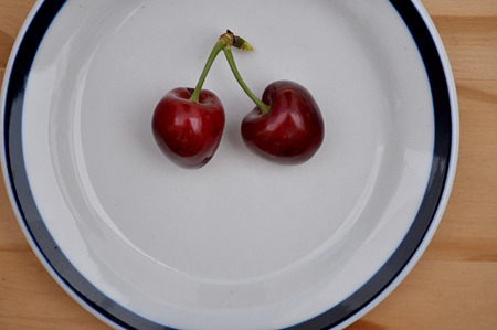 retouched: plate with shiny cherries Stock Photo