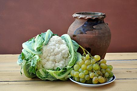 greek pot: vegetables and clay pot Archivio Fotografico