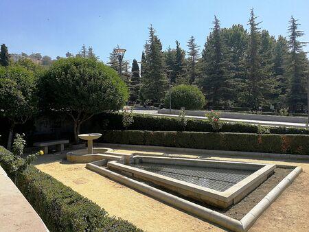 Public park with fountain in Granada, Spain, details Stock Photo