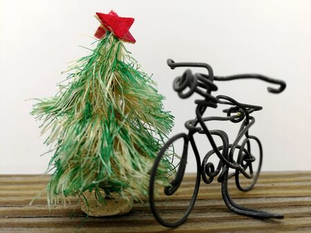 transporting the Christmas tree by bicycle Stock Photo