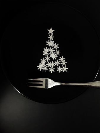 black plate for after Christmas, concept of excess stimuli