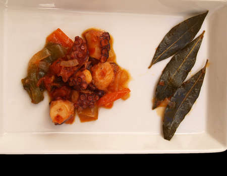 octopus with vegetables and fried laurel Stock Photo