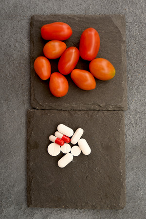 conceptual disjunctive between medicines or fruits and vegetables Standard-Bild - 110822281