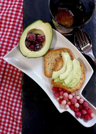 Toast with avocado, red fruits and cold drink 스톡 콘텐츠