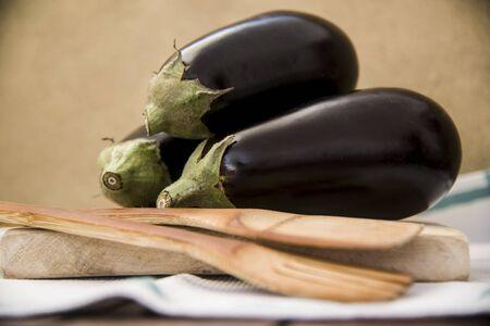 eggplants on a kitchen board