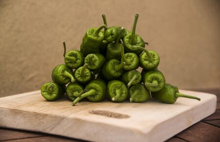 sweet green peppers bunch on a kitchen board