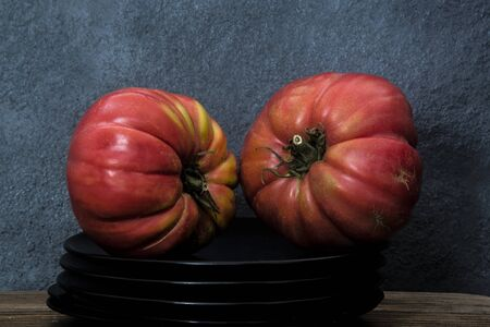 organic tomatoes with natural shape on gray background