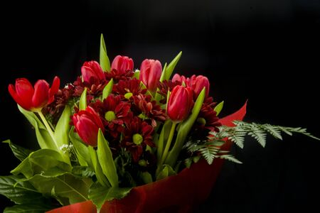vibrant bouquet of red tulips and daisies