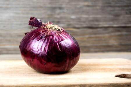 purple onion on wooden board