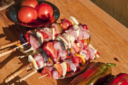 Skewers and vegetables on the table