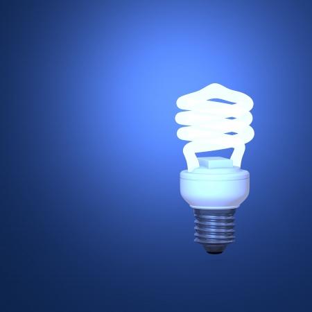 eficiencia energetica: Lámpara ahorro de energía y el fondo azul