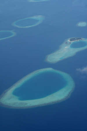 Islands of the Maldives seen from a plane Stock Photo