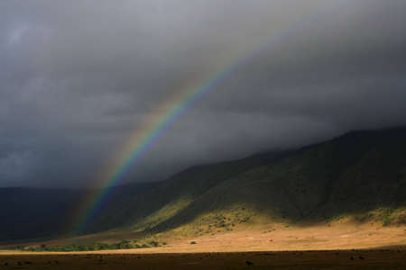 rainbow at ngorongoro crater in tanzania, africa, at early morning photo