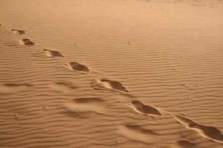 foot prints in Sand dunes of Erg Chebbi in the Sahara Desert, Morocco photo