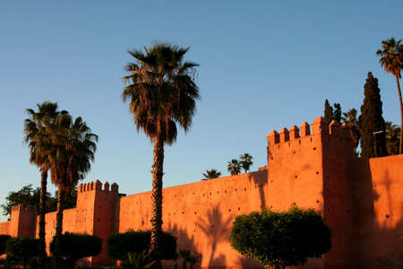 Part of city big wall in Marrakech, Morocco. Sunset