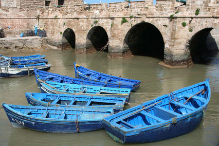 View at the fishing boats from port in Essaouira photo