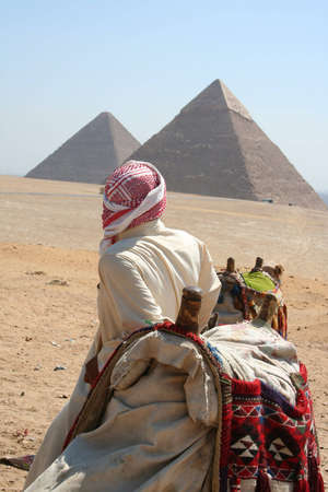 Bedouin and Camel in front of famous Pyramid og Giza (Gizeh) Stock Photo