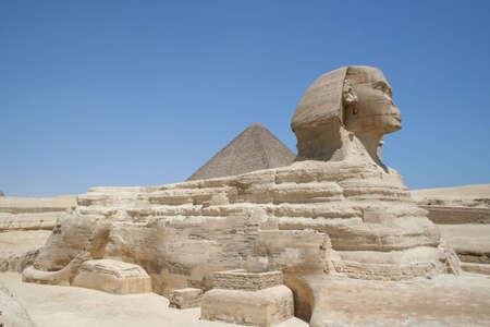 The Sphynx in front of pyramid in gaza (Gizeh) Stock Photo
