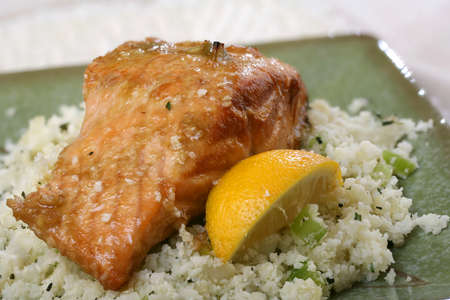 wedge: Baked Salmon with lemon wedge and rice cauliflower side dish