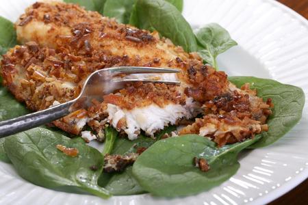 coalfish: Catfish filets coated with crushed pretzels and roasted Stock Photo