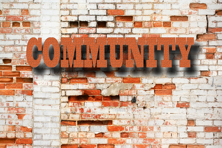 coexist: Community Concept - Community sign on decaying brick wall outdoors