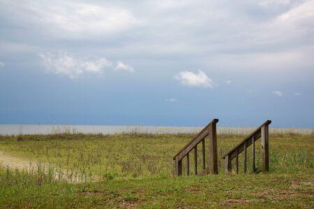 beach access: Beach access stairs ocean blue sky calm