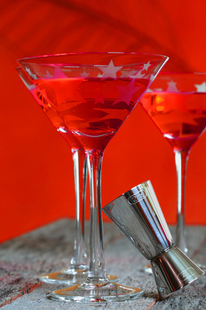 cosmo: Adult beverage Cosmo colorful drink in martini glass on weathered rustic tabletop