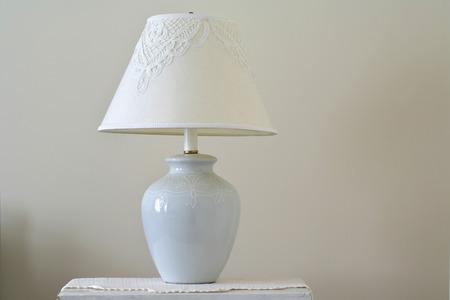 understated: Lamp on wood dresser  vintage effect style