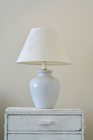 understated: Lamp on wood dresser  vintage effect style
