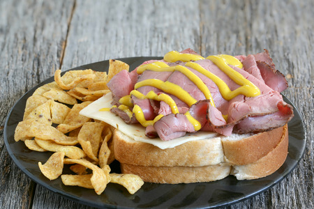 hoagie: Roast beef on bread with cheese chips mustard