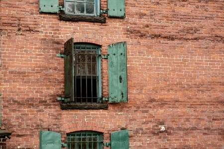 distillers: Distillery brick wall with large heavy iron door and bars Stock Photo