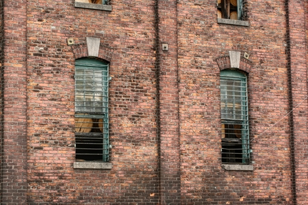 distillers: Distillery brick wall with large heavy iron bars