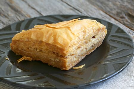 baklawa: Baklava, delicious pastry dessert made with phyllo dough, nuts, butter and sugar served on a plate