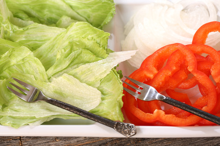 toppings: Hamburger toppings displayed on a platter ready for use Stock Photo