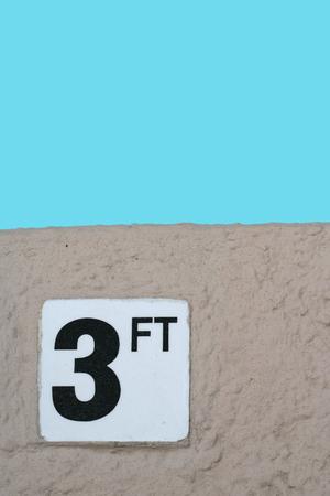no diving sign: Depth marker warning sign at pool edge for 3 ft