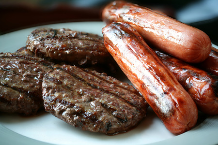 hotdogs: Grilled hamburgers and hotdogs ready to eat Stock Photo