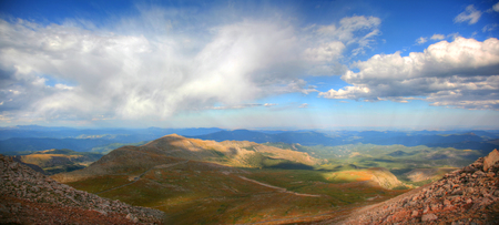 evans: Panoramic of scenic mountains range view from Mt. Evans at the summit in Colorado Stock Photo