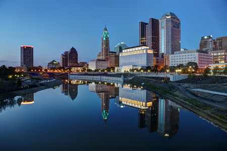 city park skyline: Scioto River and Columbus Ohio skyline at John W. Galbreath Bicentennial Park at dusk