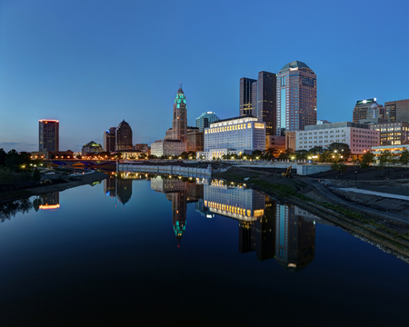 cityscapes: Scioto River and Columbus Ohio skyline at John W. Galbreath Bicentennial Park at dusk