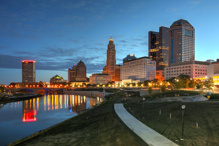 city park skyline: Scioto River and Columbus Ohio skyline at John W. Galbreath Bicentennial Park at dawn