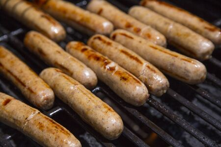 Grilled brats getting ready to serve Stock Photo