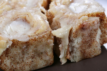 Cinnamon rolls baked fresh with icing added ready to eat Stock Photo