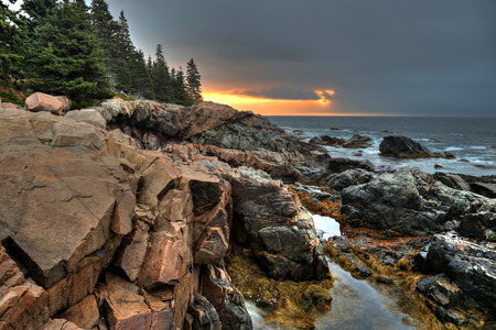 Waves crashing onto rocks near Otter Cliffs at Acadia National Park, ME