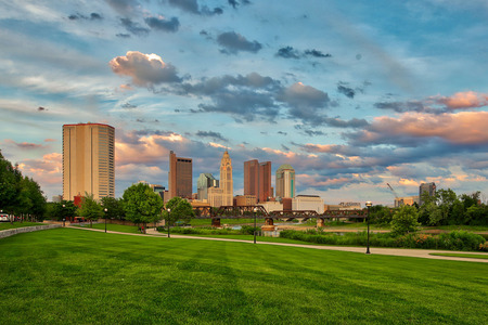 Scioto River and downtown Columbus Ohio skyline at John W. Galbreath Bicentennial Park at dusk Stock Photo