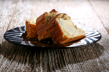 Bundt Coffee Cake sprinkled with cinnamon sugar and topped with pecans Stock Photo
