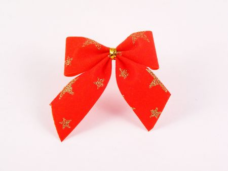 Red bow-knot with gold stars  photo