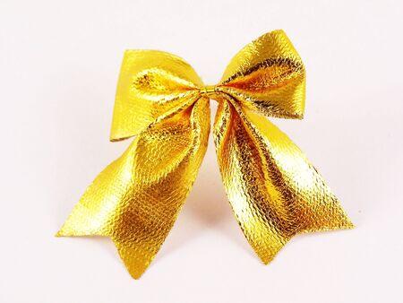 Gold  ribbon-knot on white   photo