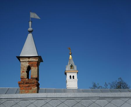 Old towers and roof on blue sky