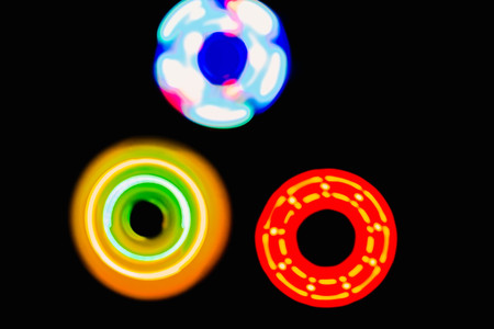 electronic background: Three Colourful circle light in dark background